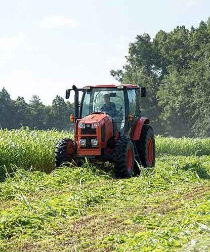 Farm tractor plowing in field