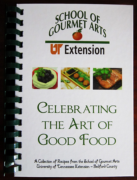 """Photo of a book titled """"Celebrating the Art of Good Cooking"""