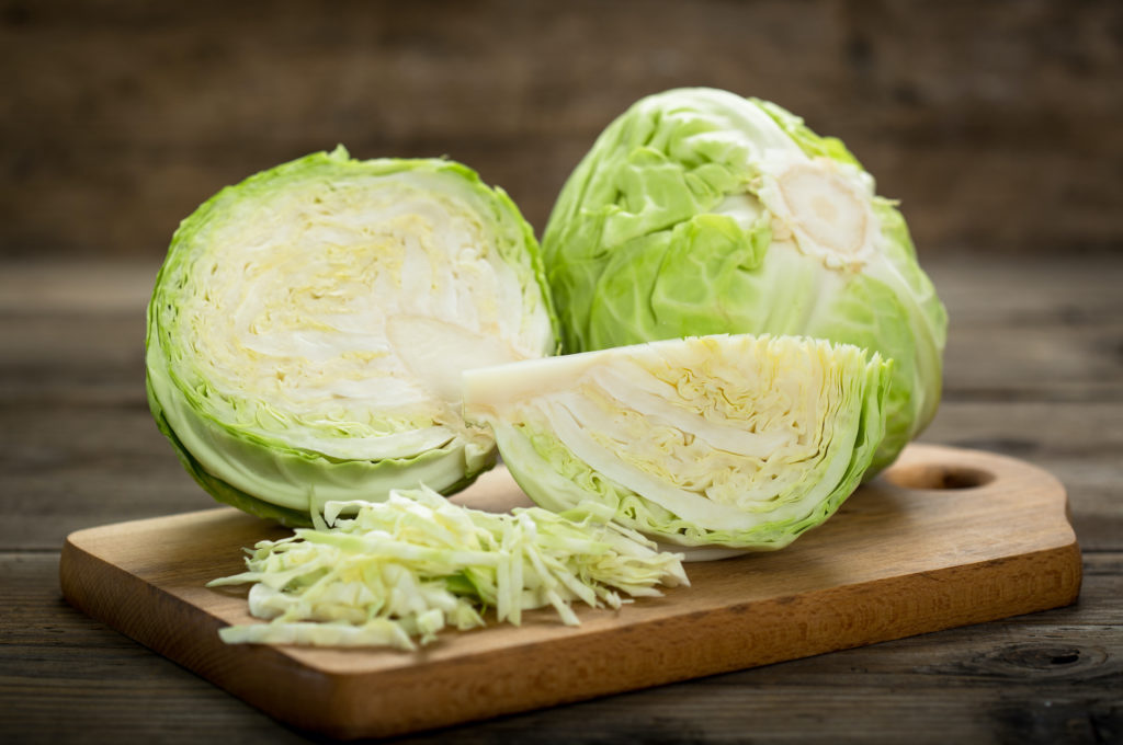 Fresh cabbage on the wooden table